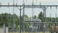 WS View of Heat waves waft pass power station with electrical grid, transformers and more / Beaverton, Oregon, United States