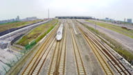 WS AERIAL View of high speed train driving on the rail,Xi'an,China.