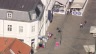 WS AERIAL View of high street in roskilde with two cyclists / Sjaelland, Denmark
