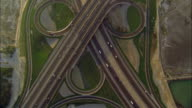 WS POV AERIAL View of highway and road junction in desert with traffic