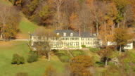 MS AERIAL ZI ZO View of Hildene surrounded by autumn color tree / Vermont, United States