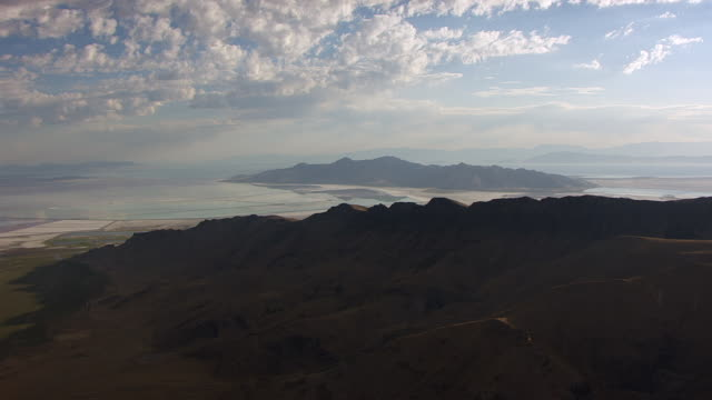 WS AERIAL View of hills and Great Salt lake and Stansbury Island / Utah, United States