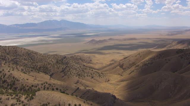 WS AERIAL View of hills with salt flats remnants southwest of Great Salt lake en route from Bonneville Salt Flats to Salt lake city / Utah, United States