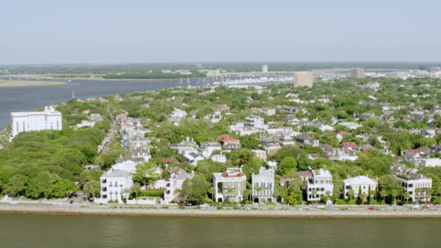 WS AERIAL POV View of historic houses, church and bridge / Charleston, South Carolina, United States