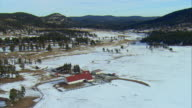 WS PAN View of horse ranch on snow covered field near Evergreen / Denver, Colorado, USA