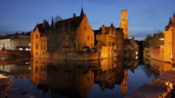 WS View of houses and tower reflected in canal at dusk / Bruges, West Flanders, Belgium