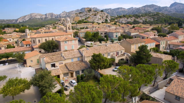 WS AERIAL View of houses at village with mountain / Aureille, Provence, France