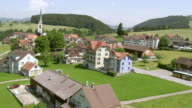 WS AERIAL View of hundwil with village square where provincial assembly takes place / Hundwil, Appenzell Ausserrhoden, Switzerland