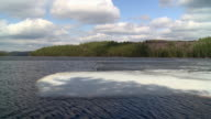 WS View of ice melting on lake Opeongo Algonquin park in spring / Whitney, Ontaria, Canada
