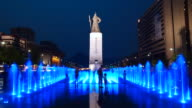 WS T/L View of Illuminated fountain at Admiral Yisunsin Statue in Gwanghwamun Square at night / Seoul, South Korea