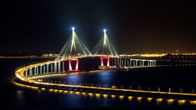 View of Incheon Bridge (A longest bridge in South Korea)and Tourboat at night