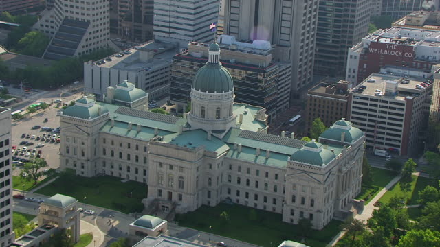 WS AERIAL POV View of Indiana State Capitol Building with city / Indianapolis, Marion County, Indiana, United States