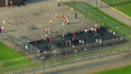 MS AERIAL View of  inmates exercise and play basketball in yard at Mound Correctional Facility / Detroit, Michigan, United States