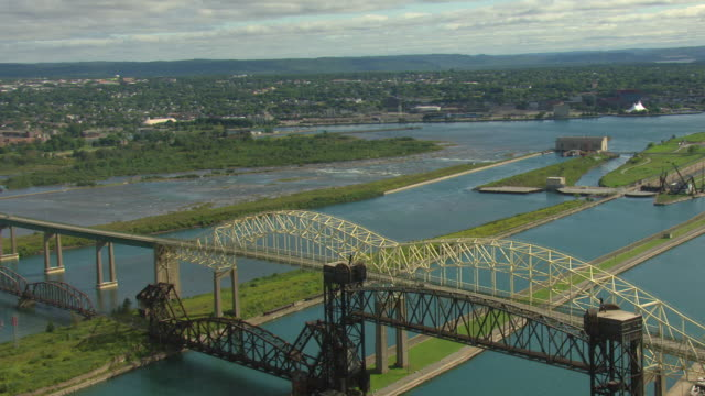 WS AERIAL View of International Bridge next to International Railroad Bridge and close to Soo Locks / Sault Ste Marie, Michigan, United States