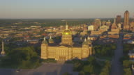 WS ZO AERIAL POV View of Iowa State Capitol and 801 Grand building at sunrise / Des Moines, Iowa, United States