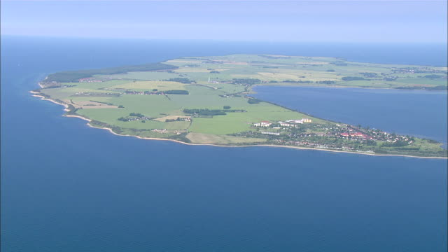 WS AERIAL View of island and city surrounded by sea / Hiddensee, Mecklenburg-Vorpommern, Germany