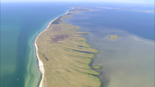 WS AERIAL PAN View of island surrounded by sea/ PrerowKirr, Mecklenburg-Vorpommern, Germany