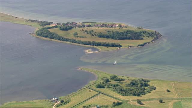 WS AERIAL View of island surrounding by sea / RuegenGreifswaldLubmin, Mecklenburg-Vorpommern, Germany