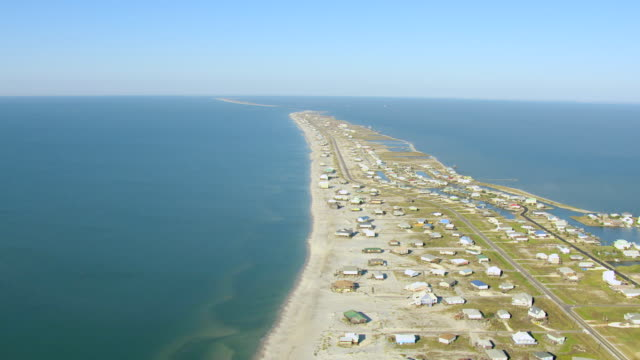 WS AERIAL View of island with beachfront houses on stilts / Dauphin Island, Alabama, United States