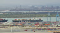 WS AERIAL View of Istres industry and steel works and Container yard / Provence-Alpes-Cote d'Azur, Switzerland