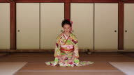 WS View of Japanese woman with kimono bowing, Japanese style sitting on Tatami floor / Yamaguchi, Yamaguchi Prefecture, Japan