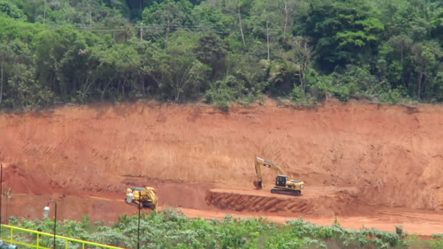WS View of JCB machines at mine in village / Serra Pelada, Para, Brazil