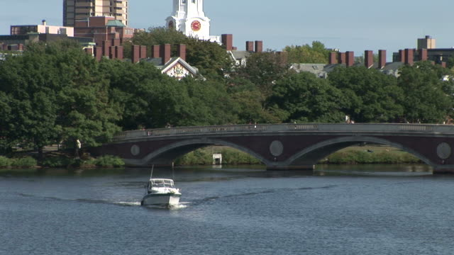 View of John W. Weeks Bridge over Charles River and the tower of Harvard University in Boston United States