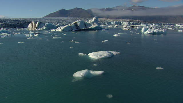 WS AERIAL View of Jokulsarlon icebergs / Iceland