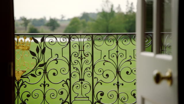 MS TD View of Kimbolton School ornamental bars with crest leading to country side / Cambridgeshire, United Kingdom