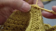 View of knitting with yellow wool
