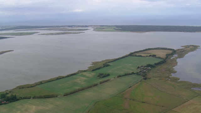 WS AERIAL View of lagoons along coastline with farmland / Germany