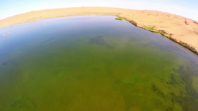 WS AERIAL View of lake in Tengger Desert/Alashan, Inner Mongolia, China.