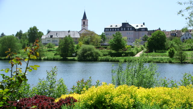 WS View of lake with church and city hall / Weiskirchen, Saarland, Germany