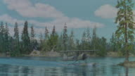 WS TS View of lake with trees in back side with boat plane lands in water (miniature)