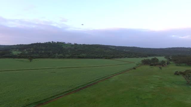 WS AERIAL View of Land and helicopter flying / Coolgardie and Kalgoorlie, Western Australia, Australia