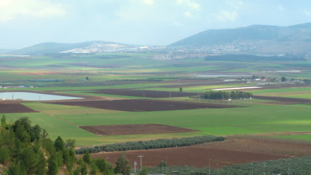 WS PAN View of landscape with mountain in background / Jezreel Valley,  Isarel