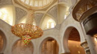 MS PAN View of Large colourful chandelier in beautiful white Sheikh Zayed Grand Mosque in Abu Dhabi / Abu Dhabi, United Arab Emirates
