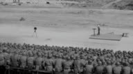 WS View of large group of soldiers seating during training as instructor speaks