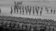 WS View of large group of soldiers seating during training as platoon stand