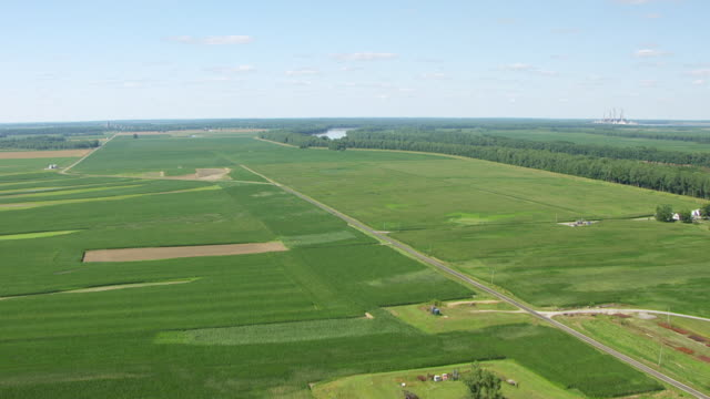 WS AERIAL POV View of large landscape with crop fields, Wabash River in background / Wabash County, Mount Carmel, Illinois, United States