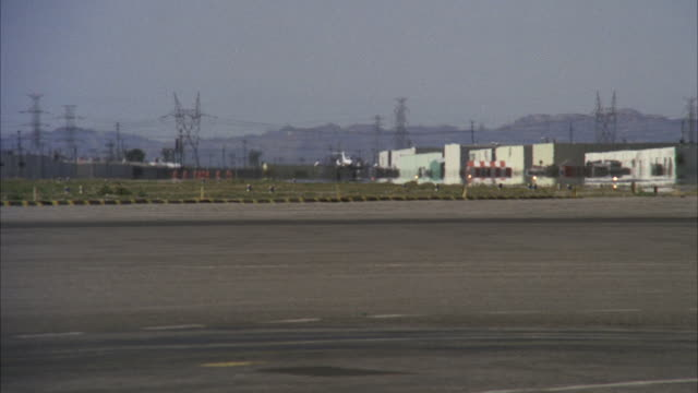 MS TS View of Lear company jet landing on airfield