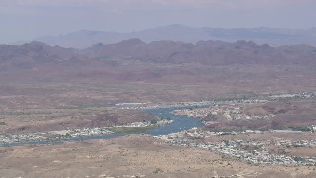 WS AERIAL View of Leaving Parker and Colorado River / Arizona, United States