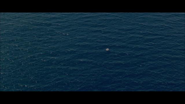 AERIAL CU View of life raft on choppy ocean