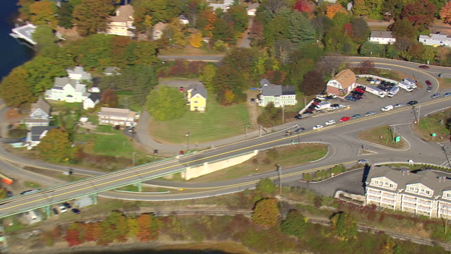 MS AERIAL PAN ZI View of Lifting Bridge and traffic moving on Maine Turnpike Bridge / New Hampshire, United States