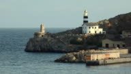 WS View of lighthouse by bay / Port de Soller, Mallorca, Baleares, Spain