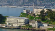 WS DS AERIAL View of Lighthouse of Alcatraz Island and prison complex / San Francisco, California, United States