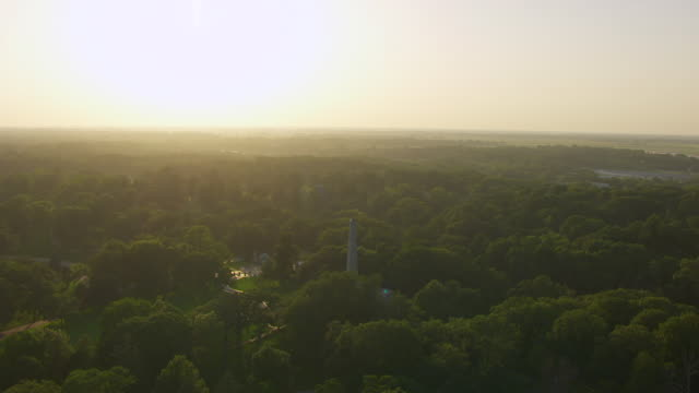 WS AERIAL POV View of Lincoln Tomb covered by trees / Springfield, Illinois, United States
