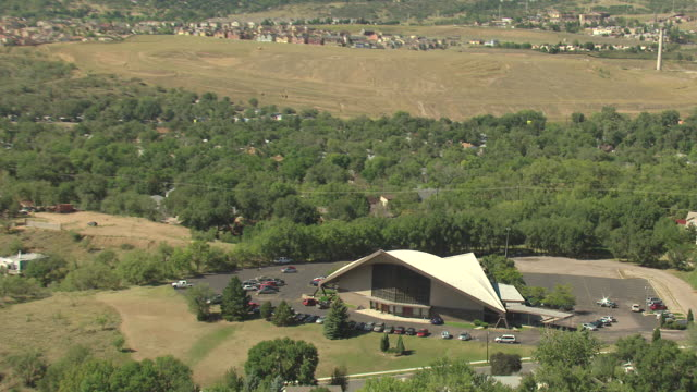 WS DS ZI AERIAL View of living hope church and mountains with modern church building with white roof / Colorado Springs, Colorado, United States