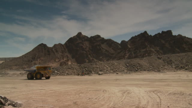 WS View of loaded dump truck driving through opencast mine / Namibia