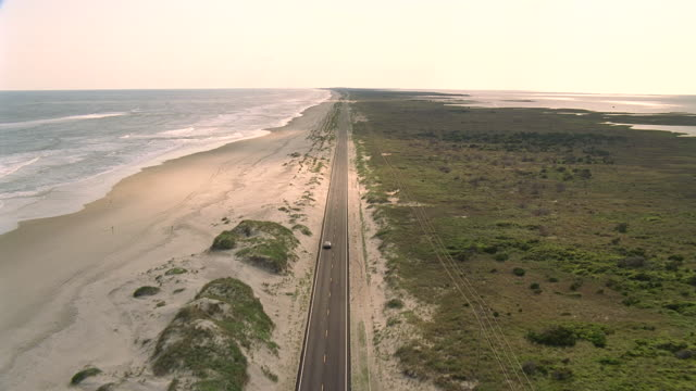 WS AERIAL ZI TS View of long road with ocean on left